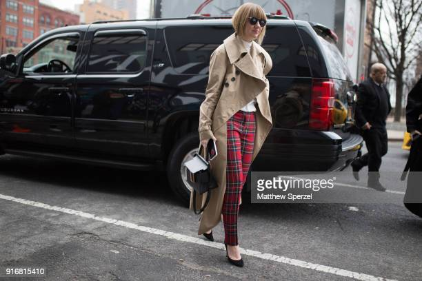 Lisa Aiken is seen on the street attending Dion Lee during New York Fashion Week wearing red plaid pants on February 10 2018 in New York City
