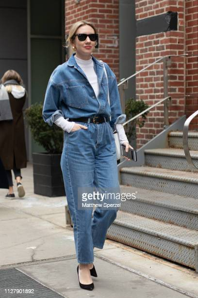 Lisa Aiken is seen on the street attending Rachel Comey during Men's Fashion Week New York wearing denim jumpsuit with white turtleneck and black...