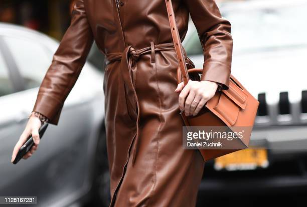 Lisa Aiken is seen wearing a leather coat and brown leather bag outside the Maryam Nassir Zadeh show during New York Fashion Week: Women's...
