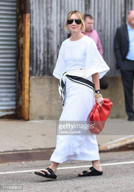 Lisa Aiken is seen wearing a white dress and red bag outside the Michael Kors show during New York Fashion Week S/S20 on September 11 2019 in New...