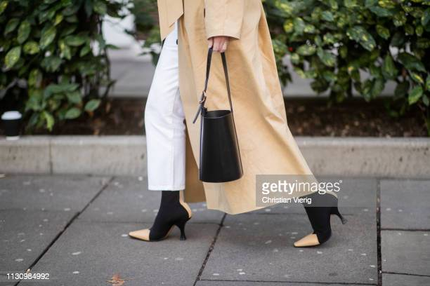 Lisa Aiken is seen wearing balack bag two tone boots trench coat outside Shrimps during London Fashion Week February 2019 on February 19 2019 in...