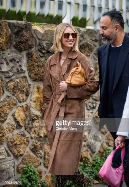 Lisa Aiken is seen wearing brown wild leather coat Khaite boots outside Loewe during Paris Fashion Week Womenswear Fall/Winter 2020/2021 Day Five on...