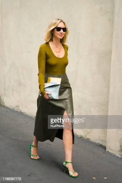 Lisa Aiken is seen wearing olive skirt with slit mustard top outside the Prada show during Milan Fashion Week Spring/Summer 2020 on September 18 2019...