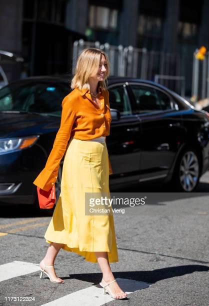 Lisa Aiken is seen wearing orange button shirt and yellow skirt outside Self-Portrait during New York Fashion Week September 2019 on September 07,...