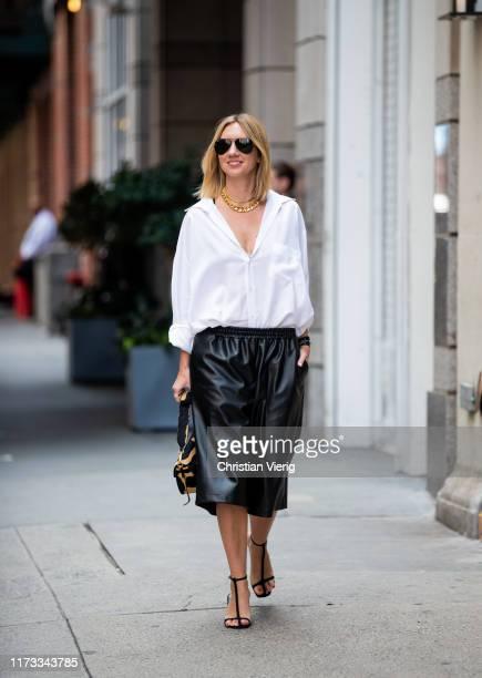 Lisa Aiken is seen wearing white blouse black shorts outside Tibi during New York Fashion Week September 2019 on September 08 2019 in New York City