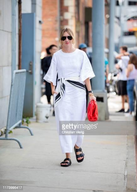 Lisa Aiken is seen wearing white dress outside Michael Kors during New York Fashion Week September 2019 on September 11, 2019 in New York City.