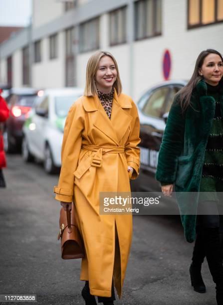 Lisa Aiken is seen wearing yellow coat brown bag outside Baum und Pferdgarten during the Copenhagen Fashion Week Autumn/Winter 2019 Day 3 on January...