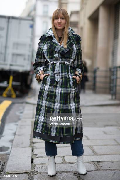 Lisa Aiken poses wearing a Burberry trench coat after the Acne Studios show during Paris Fashion Week Haute Couture Spring Summer 2018 on January 24...