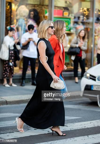 Lisa Aiken seen weairng mini clutch outside the Bottega Veneta show during Milan Fashion Week Spring/Summer 2020 on September 19 2019 in Milan Italy