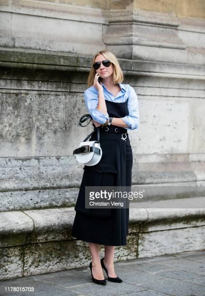 Lisa Aiken seen wearing blue button shirt, black skirt, Proenza Schouler bag during Paris Fashion Week Womenswear Spring Summer 2020 on September 29,...