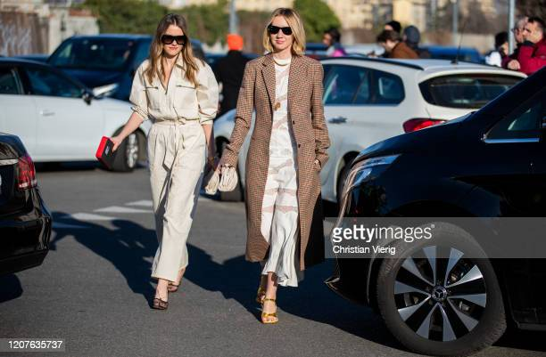 Lisa Aiken seen wearing brown checkered coat outside Prada during Milan Fashion Week Fall/Winter 2020-2021 on February 20, 2020 in Milan, Italy.