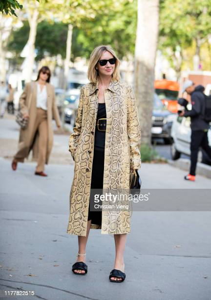 Lisa Aiken seen wearing coat with yellow snake print black belted dress Bottega Veneta shoes outside Haider Ackermann during Paris Fashion Week...