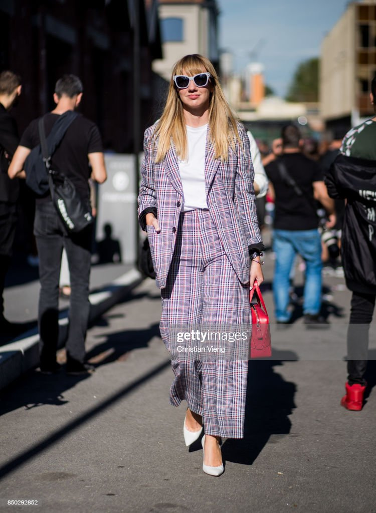Lisa Aiken wearing a checked grey suit is seen outside Gucci during Milan Fashion Week Spring/Summer 2018 on September 20, 2017 in Milan, Italy.