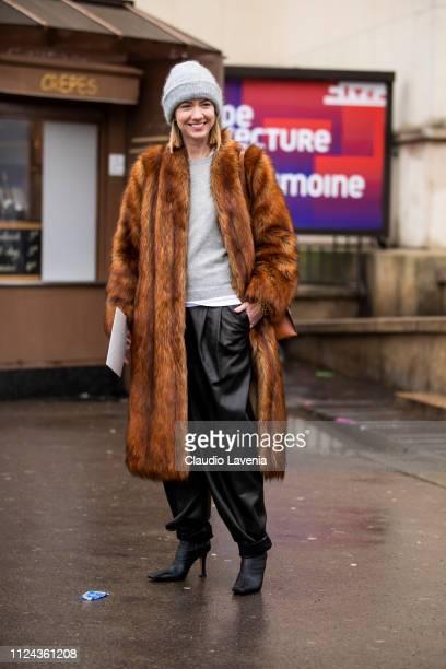 Lisa Aiken wearing a grey jumper black leather pants black heels grey hat and brown fur coat is seen outside Elie Saab show during Paris Fashion Week...