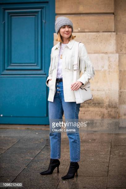 Lisa Aiken wearing a white tshirt blue jeans black boots white fringed jacket grey hat and white bag is seen outside Alexis Mabille show during Paris...
