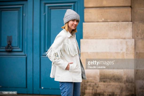 Lisa Aiken wearing a white tshirt blue jeans white fringed jacket grey hat and white bag is seen outside Alexis Mabille show during Paris Fashion...