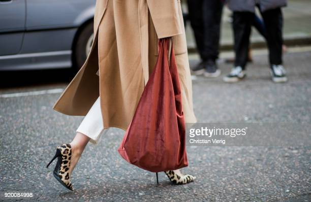 Lisa Aiken wearing bag seen outside Temperley London during London Fashion Week February 2018 on February 18 2018 in London England