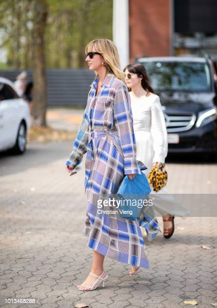 Lisa Aiken wearing blue clutch checked dress is seen outside Holzweiler during the Copenhagen Fashion Week Spring/Summer 2019 on August 8 2018 in...