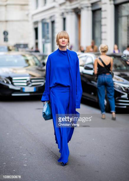 Lisa Aiken wearing blue dress is seen outside Salvatore Ferragamo during Milan Fashion Week Spring/Summer 2019 on September 22 2018 in Milan Italy