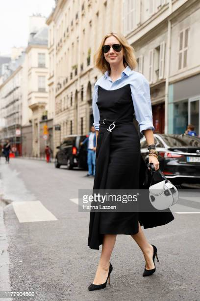 Lisa Aiken wearing blue shirt black dress and Proenza Schoulerbag outside Thom Browne show during Paris Fashion Week Womenswear Spring Summer 2020 on...