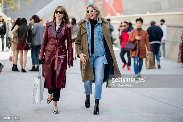 Lisa Aiken wearing bordeaux belted leather coat Loewe bag with fringes and a guest wearing olive parka cropped denim jeans denim jacket seen at the...