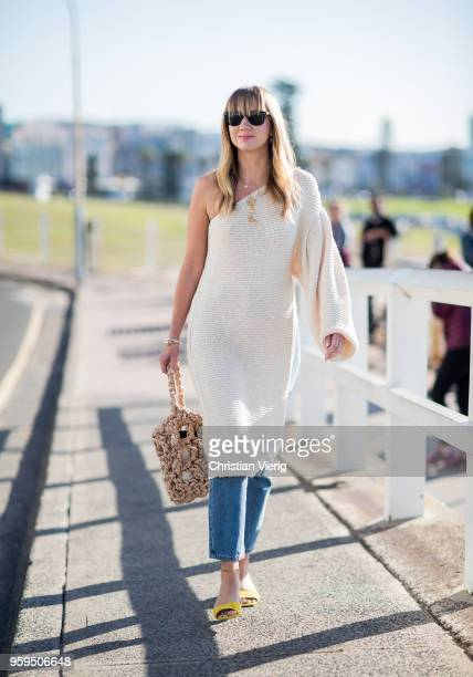 Lisa Aiken wearing cashmere dress bucket bag during MercedesBenz Fashion Week Resort 19 Collections at Icebergs Dining Room on May 17 2018 in Sydney...