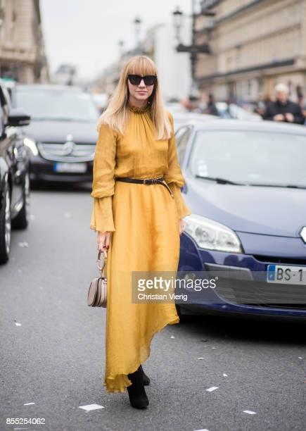 Lisa Aiken wearing Chloe bag yellow dress is seen outside Balmain during Paris Fashion Week Spring/Summer 2018 on September 28 2017 in Paris France