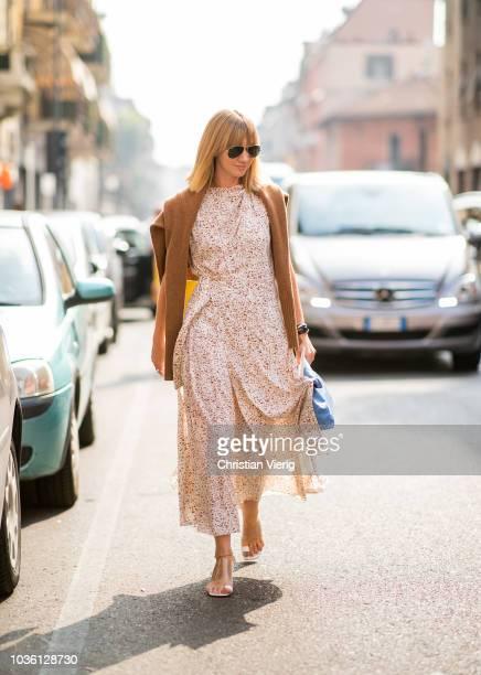 Lisa Aiken wearing dress is seen outside Jil Sander during Milan Fashion Week Spring/Summer 2019 on September 19 2018 in Milan Italy