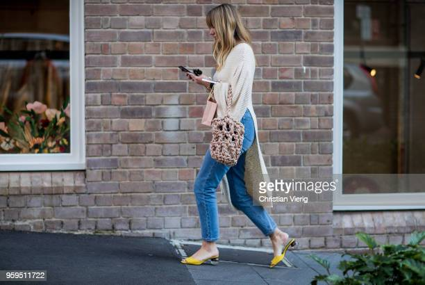 Lisa Aiken wearing dress with slit denim jeans during MercedesBenz Fashion Week Resort 19 Collections at Carriageworks on May 17 2018 in Sydney...