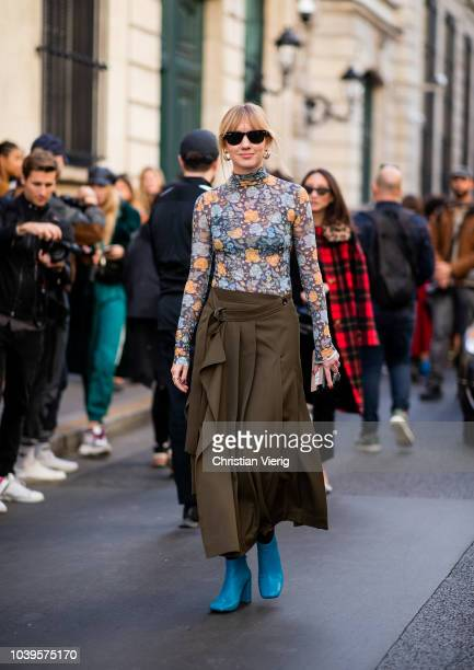 Lisa Aiken wearing long shirt with floral print midi skirt is seen outside Jacquemus during Paris Fashion Week Womenswear Spring/Summer 2019 on...