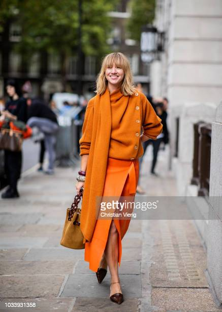 Lisa Aiken wearing orange knit and skirt with slit and bag heels is seen outside ALEXACHUNG during London Fashion Week September 2018 on September 15...