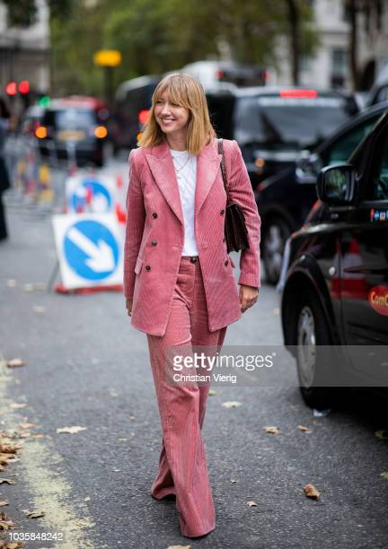 Lisa Aiken wearing pink corduroy suit is seen outside Richard Quinn during London Fashion Week September 2018 on September 18 2018 in London England