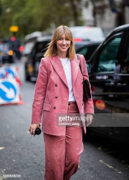 Lisa Aiken wearing pink corduroy suit is seen outside Richard Quinn during London Fashion Week September 2018 on September 18, 2018 in London,...