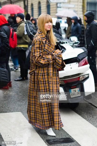 Lisa Aiken wearing plaid coat outside Loewe on March 2 2018 in Paris France