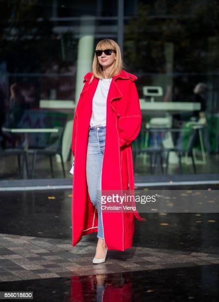 Lisa Aiken wearing red coat is seen outside Haider Ackermann during Paris Fashion Week Spring/Summer 2018 on September 30 2017 in Paris France
