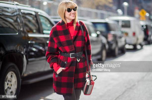 Lisa Aiken wearing red plaid lumberjack coat seen outside Gabriela Hearst on February 13 2018 in New York City