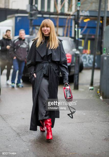Lisa Aiken wearing striped belted coat seen outside Marques Almeida during London Fashion Week February 2018 on February 19 2018 in London England