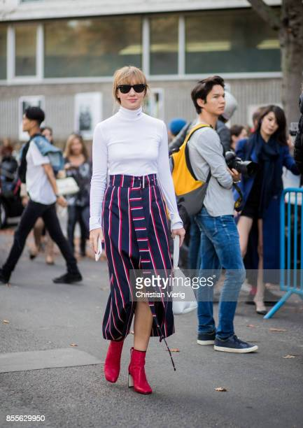 Lisa Aiken wearing striped skirt white bag red ankle boots is seen outside Loewe during Paris Fashion Week Spring/Summer 2018 on September 29 2017 in...