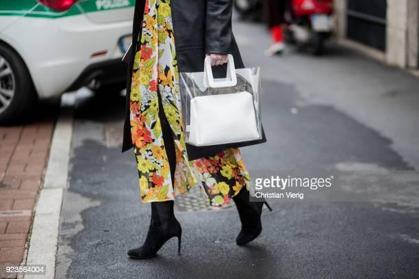 Lisa Aiken wearing transparent see through bag seen outside Etro during Milan Fashion Week Fall/Winter 2018/19 on February 23 2018 in Milan Italy
