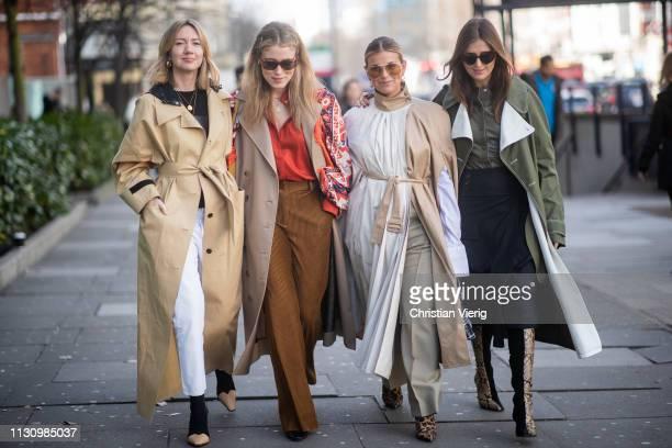 Lisa Aiken wearing trench coat, Janka Polliani is seen wearing white brown dress and Darja Barannik is seen wearing two tone Celine boots with snake...