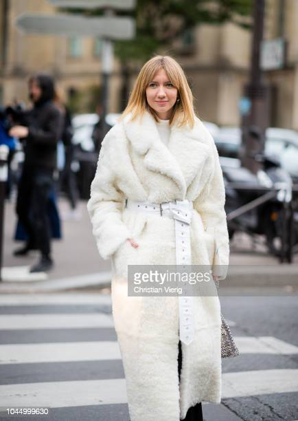 Lisa Aiken wearing white belted teddy coat is seen outside Miu Miu during Paris Fashion Week Womenswear Spring/Summer 2019 on October 2 2018 in Paris...