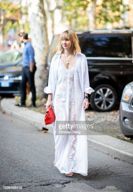 Lisa Aiken wearing white sheer dress is seen outside Marni during Milan Fashion Week Spring/Summer 2019 on September 23 2018 in Milan Italy