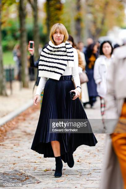 Lisa Aiken wears a black and white striped pullover a pleated skirt outside Beautiful People during Paris Fashion Week Womenswear Spring/Summer 2019...