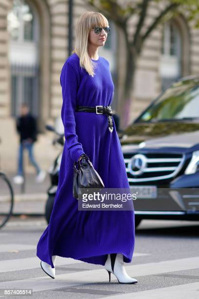 Lisa Aiken wears a blue dress outside Thom Browne during Paris Fashion Week Womenswear Spring/Summer 2018 on October 3 2017 in Paris France