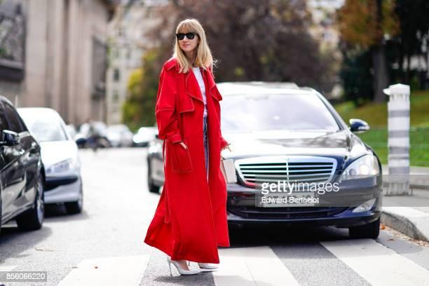 Lisa Aiken wears a red coat a white top blue jeans outside Mugler during Paris Fashion Week Womenswear Spring/Summer 2018 on September 30 2017 in...