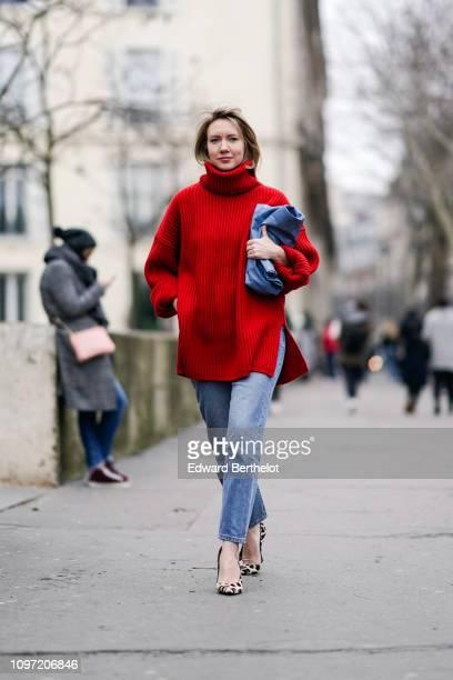 Lisa Aiken wears a red turtleneck, blue denim jeans, leopard print shoes, outside Acne, during Paris Fashion Week - Menswear F/W 2019-2020, on...