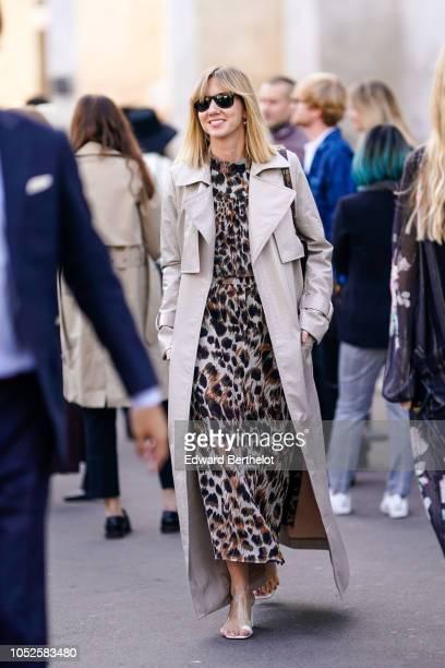 Lisa Aiken wears a trench coat a leopard print dress outside Haider Ackermann during Paris Fashion Week Womenswear Spring/Summer 2019 on September 29...