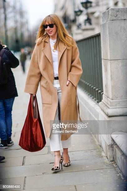 Lisa Aiken wears a trench coat during London Fashion Week February 2018 on February 18 2018 in London England