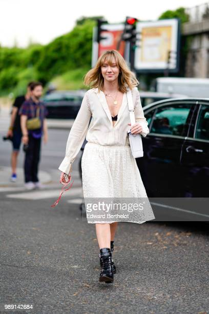 Lisa Aiken wears a white lace dress outside Vetements during Paris Fashion Week Haute Couture Fall Winter 2018/2019 on July 1 2018 in Paris France