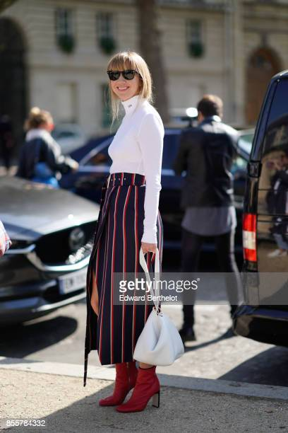 Lisa Aiken wears a white top a striped skirt red shoes outside Nina Ricci during Paris Fashion Week Womenswear Spring/Summer 2018 on September 29...